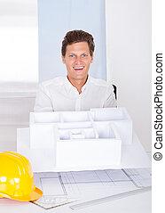 Architect Holding House Model