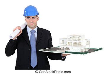 Architect holding model housing