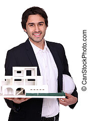 Architect holding scale model of housing