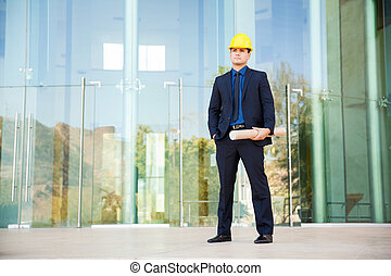 Architect in a suit and helmet