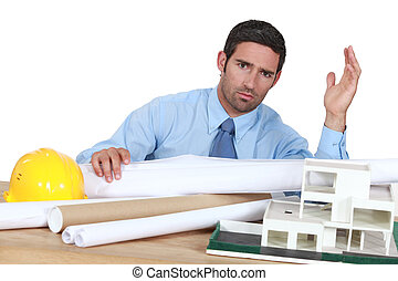 architect in his office looking angry