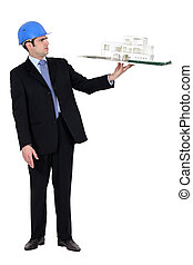 architect in suit holding model looking annoyed