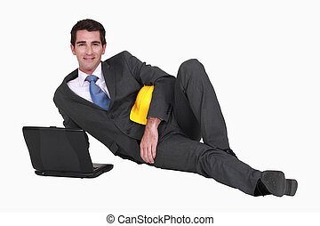 Architect laying on floor with laptop
