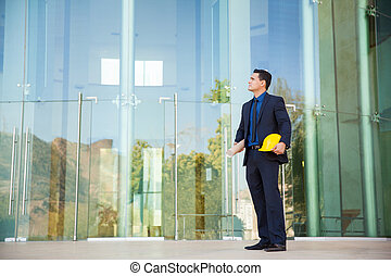 Architect looking at a building