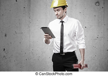Architect looking at a touchpad