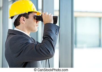 architect looking at construction site