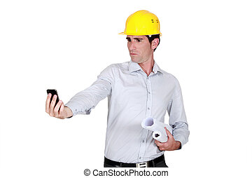 Architect looking at his cellphone