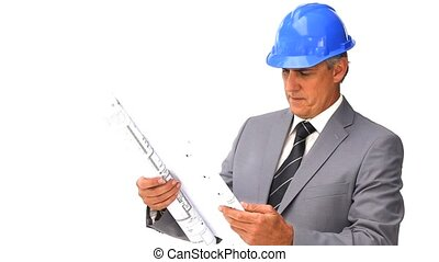 Architect looking at his construction plan