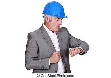 Architect looking at wrist watch