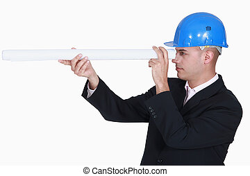 Architect looking through rolled-up plans
