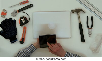 Architect male hands using digital tablet in the office