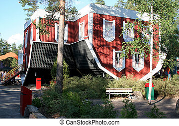 Architect Mistake - Upturned house in amusement park near...
