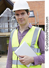 Architect On Building Site With Digital Tablet