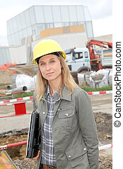 Architect on construction site with security helmet