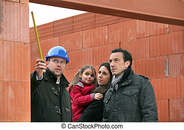 Architect on site with a young family