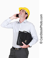 architect on the phone holding briefcase