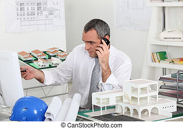 Architect on the phone in his office