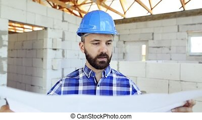 Architect or civil engineer at the construction site. -...