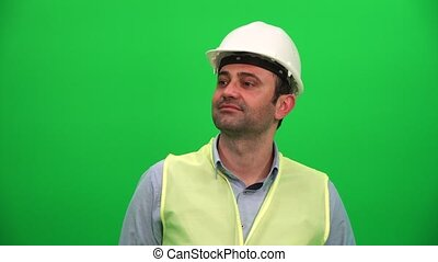 Architect or Construction Worker Looking Up on Green Screen