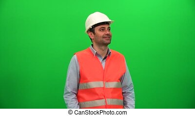 Architect or Engineer Worker Looking Around on Green Screen
