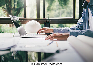 Architect or engineer working in office, Construction...