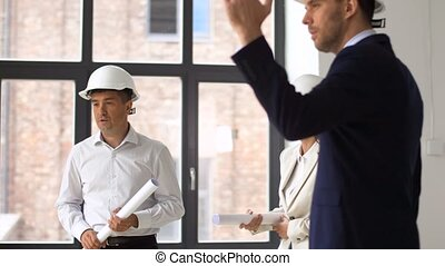 architect or realtor showing office to customers -...