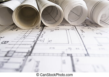 technical project drawing, close up on project, planning of interiors design on paper, construction plan in rolls, architectural project