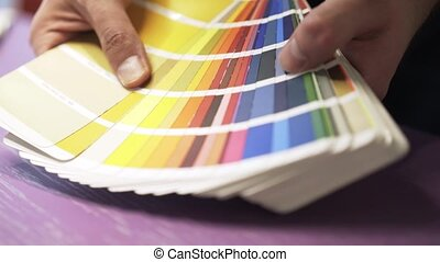 Architect s hands with a color chart