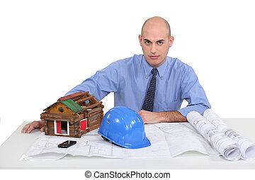 Architect sat at his desk
