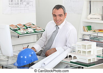 Architect sat working at desk