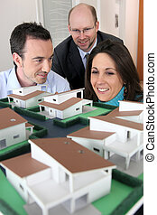 Architect showing model housing to customers