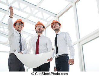 architect shows the customer a new building