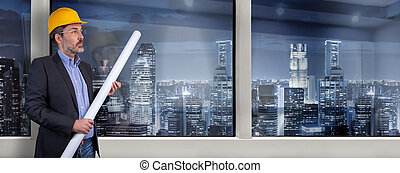 architect standing next to office window