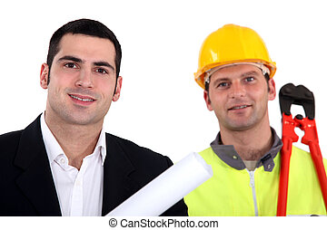 Architect standing with laborer