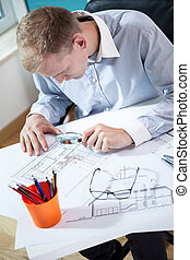 Architect studying the project