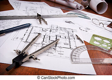 engineer, architect or contractor plans and tools laid out on a wooden table