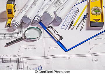 architect tools on white blueprint construction concept