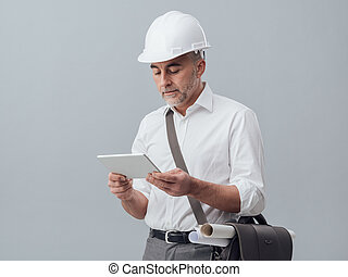Architect using a digital tablet