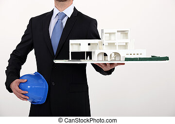 Architect with a model of a commercial development