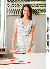 Architect with Color Swatches - A young female architect...