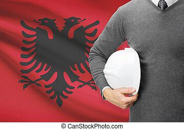 Architect with flag on background - Albania