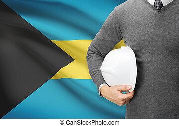 Architect with flag on background - Bahamas