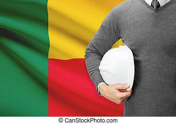 Architect with flag on background - Benin
