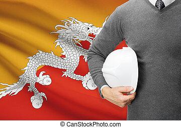 Architect with flag on background - Bhutan