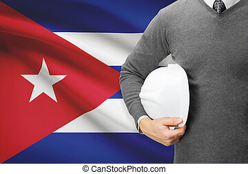 Architect with flag on background - Cuba