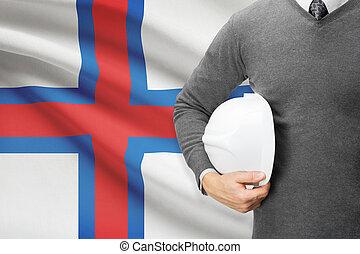 Architect with flag on background - Faroe Islands