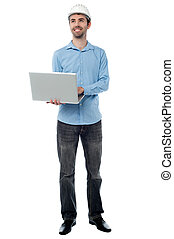 Architect with laptop, full length.
