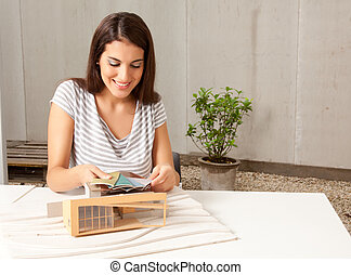 Architect with Model and Color Swatches - A young female...