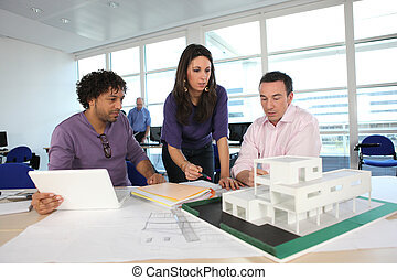 Architect with plans and 3D model