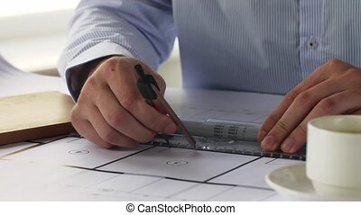 architect with ruler measuring blueprint - architecture,...